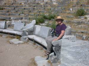 Trying out the seats in an ancient Greek theater in Turkey