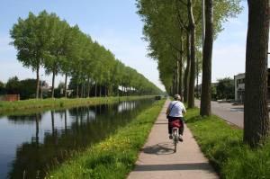 Biking down the canal near Bruges, Belgium