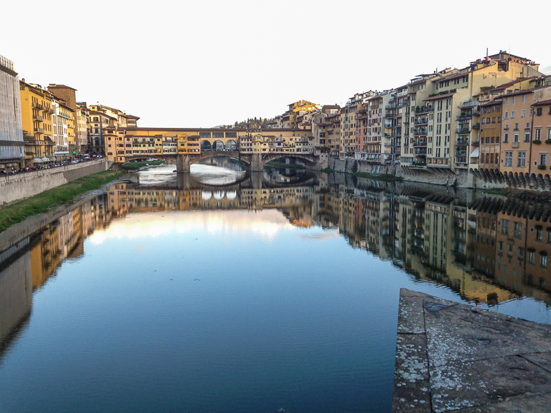 reflection view of the Ponte Vecchio and the Arno