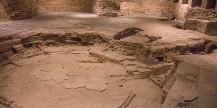 At the back of the church was an entrance to the basement. But this church basement held history, not potlucks. The remains of an ancient baptismal area have been preserved here. Note the octagonal shape - characteristic of baptismal pools.