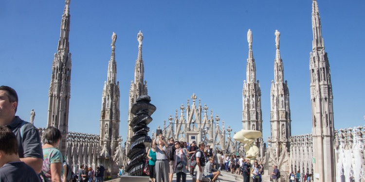The roof of the Milan cathedral was crowded with tourists taking pictures and enjoying the views. In addition to the expected spires, there were a bunch of these squiggly modern art sculptures up there. Makes no sense to me.