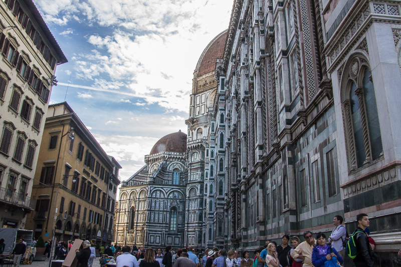 Tourists pass by the Duomo in Florence, Italy.