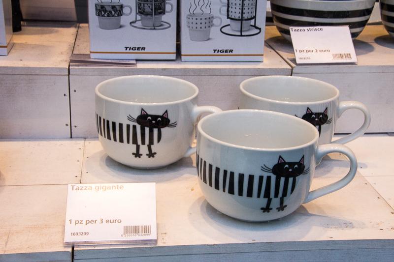 mugs in a shop window