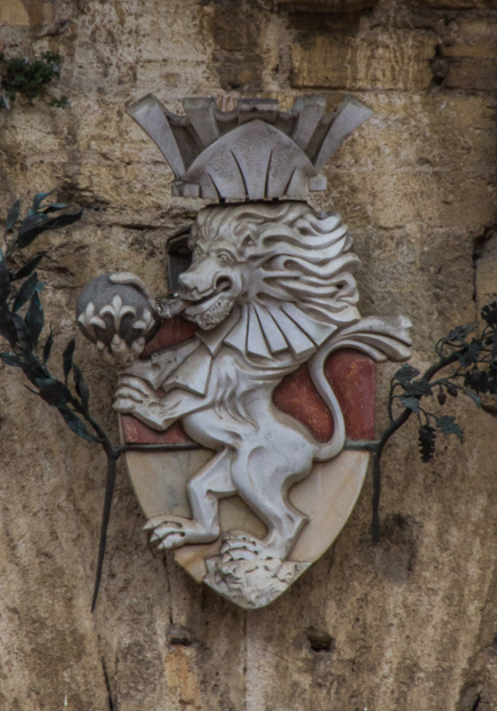 Lion insignia on the wall of San Gimignano