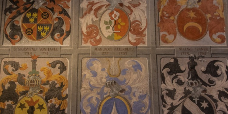 Various coats of arms painted on the wall of a room in Castle Chillon.